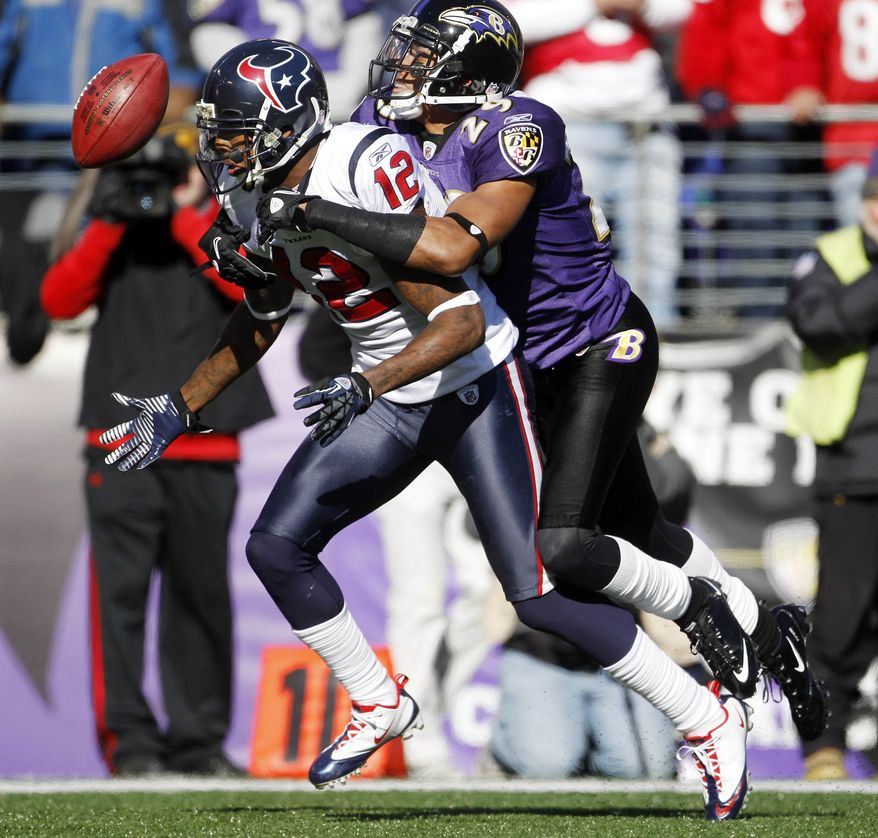 Houston Texans wide receiver Jacoby Jones fumbles the ball under pressure from Baltimore Ravens cornerback Cary Williams during the first half of the divisional playoff football game in Baltimore, Sunday, Jan. 15, 2012. (AP Photo/Evan Vucci)