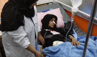 Asmar Abboud, 31, wounded in a bombing attack on Shiite pilgrims on Saturday, is treated at a hospital in Basra, Iraq, 340 miles southeast of Baghdad, on Sunday, Jan. 15, 2012. (AP Photo/Nabil al-Jurani)