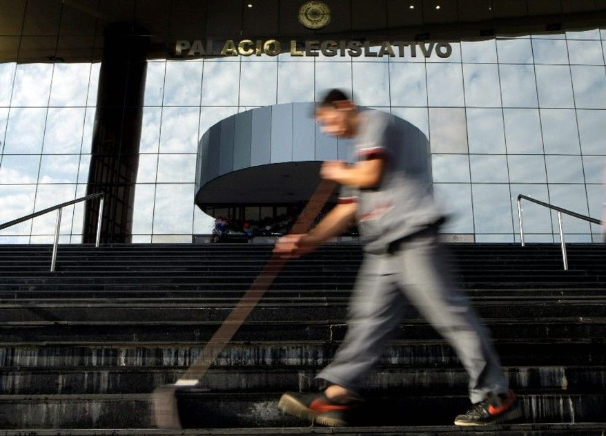 Keeping the National Congress building clean and tidy goes on in Asuncion, Paraguay, even as Congress closed its doors in mid-December for more than two months of paid vacation. When lawmakers return to work in March, they are expected to have no interest in giving President Fernando Lugo anything on his wish list during his remaining 15 months in office. (Associated Press)