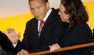 Muhammad Ali, with his wife, Lonnie, waves to friends at a party for his 70th birthday at the Muhammad Ali Center in his hometown, Louisville, Ky., on Saturday, Jan. 14, 2012. The event, a fundraiser for the center, was the first of five planned in his honor. (Associated Press)