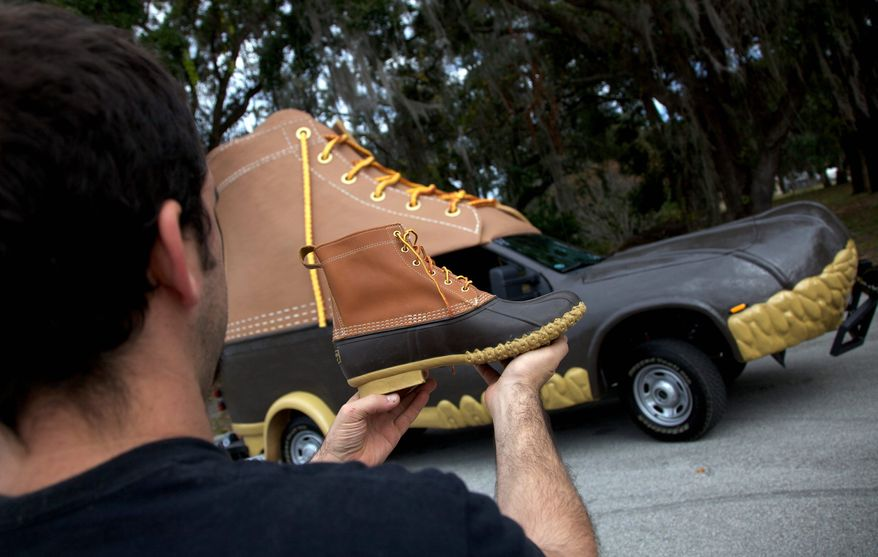 "The L.L. Bean ""Bootmobile"" is ready to roll as the family-owned business marks its 100th birthday. Founder Leon Leonwood Bean sold his first pair of hunting boots in 1912 and expanded by selling only merchandise he liked and used. (L.L. Bean via Associated Press) ** FILE **"