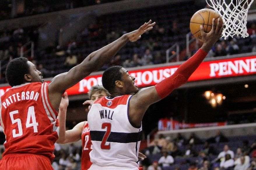 Wizards guard John Wall rang up 38 points, but his effort couldn't prevent Washington from losing 114-106 and dropping to 1-12. (Associated Press)