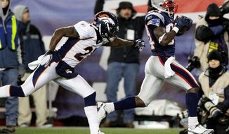 Denver Broncos cornerback Andre' Goodman (21) tries to stop New England Patriots wide receiver Deion Branch (84) as he scores on a 61-yard touchdown during the first half of an NFL divisional playoff football game Saturday, Jan. 14, 2012, in Foxborough, Mass. (AP Photo/Stephan Savoia)