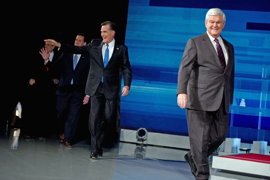 From left, GOP presidential hopefuls Rick Perry, Rick Santorum, Mitt Romney and Newt Gingrich take the stage for a debate at the Myrtle Beach Convention Center, Myrtle Beach, S.C., Monday night. (Andrew Harnik/The Washington Times)