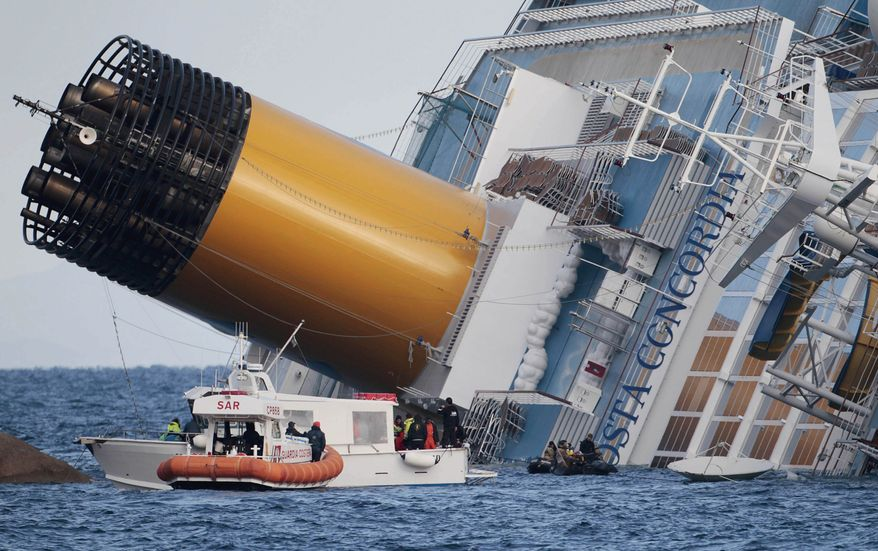 Italian firefighters conduct search operations on the luxury cruise ship Costa Concordia on Sunday, Jan. 15, 2012, after the vessel ran aground the previous Friday night off the tiny Tuscan island of Isola del Giglio in Italy. (AP Photo/Gregorio Borgia)