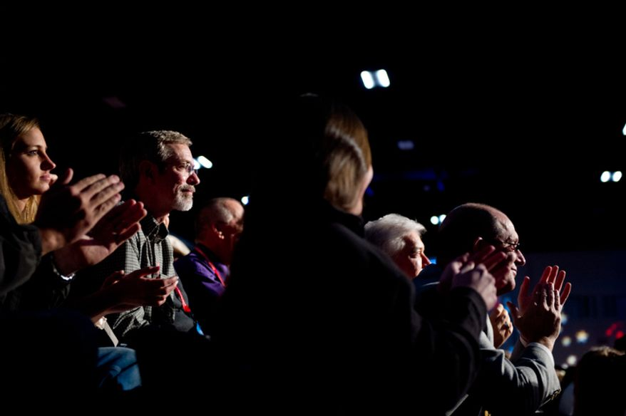 Members of the audience applaud as Republican presidential hopefuls Rick Perry, Rick Santorum, Mitt Romney, and Newt Gingrich attend a Presidential Debate held by The South Carolina Republican Party, Fox News Channel, The Wall Street Journal, and Twitter at the Myrtle Beach Convention Center, Myrtle Beach, SC, Monday, January 16, 2012.(Andrew Harnik / The Washington Times)