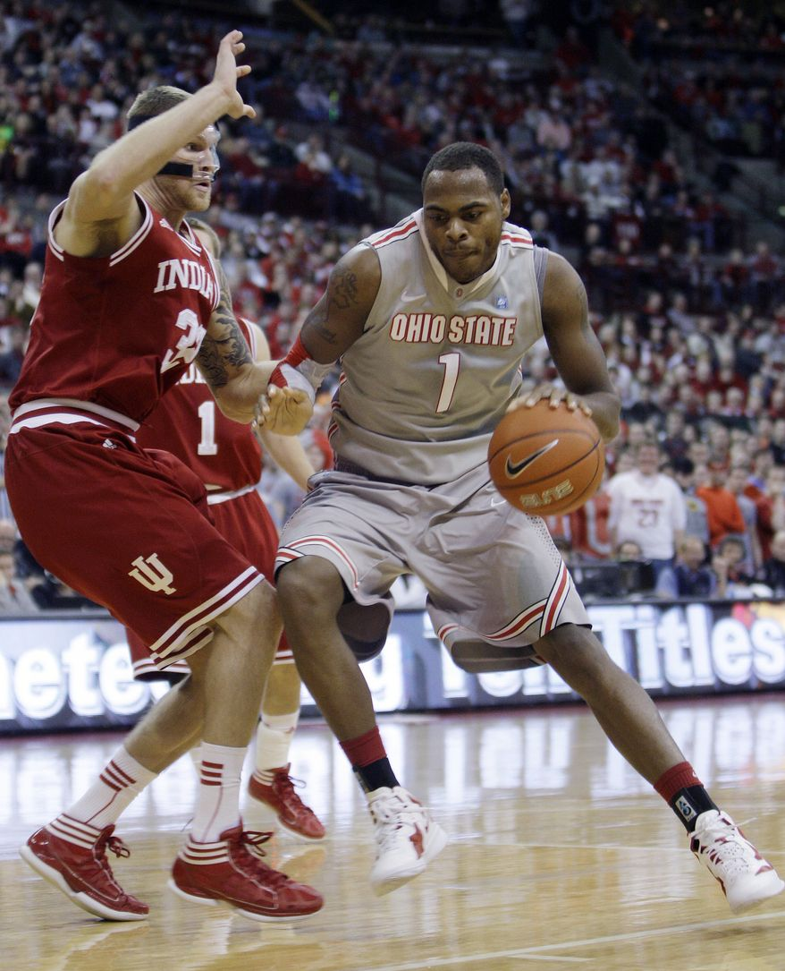 Ohio State's Deshaun Thomas, right, drives to the basket against Indiana's Derek Elston during the second half of an NCAA basketball game Sunday, Jan. 15, 2012, in Columbus, Ohio. Ohio State beat Indiana 80-63. (AP Photo/Jay LaPrete)