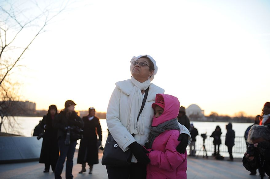 Sandra Everett of Springdale, Md., holds her 7-year-old granddaughter, Jada Shepherd, as they pay a visit to the Martin Luther King Jr. Memorial on the National Mall in Washington on Monday, Jan. 16, 2012. (Rod Lamkey Jr./The Washington Times)