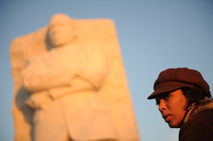 Alicia Watkins of Washington arrives for the wreath-laying ceremony at the foot of the Stone of Hope at the Martin Luther King Jr. Memorial on the National Mall in Washington on Monday, Jan. 16, 2012. (Rod Lamkey Jr./The Washington Times)