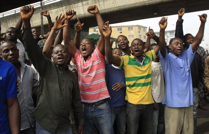 Angry youths protest and shout slogans Jan. 16, 2012, in Lagos, Nigeria. For the first time since protests erupted over spiraling fuel prices, soldiers barricaded key roads in Nigeria's two biggest cities as the president offered a concession to stem demonstrations he said were being stoked by provocateurs seeking anarchy. (Associated Press)