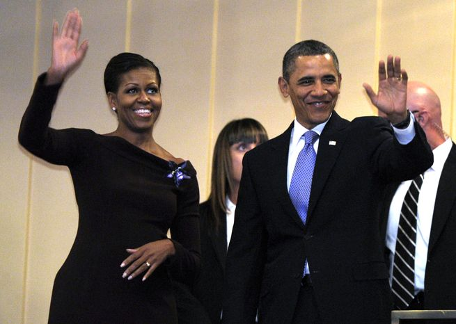 **FILE** President Obama and first lady Michelle Obama attend the Let Freedom Ring Celebration in honor of Dr. Martin Luther King at the Kennedy Center in Washington on Jan. 16, 2012. (Associated Press)