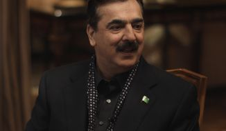 Pakistani Prime Minister Yousuf Raza Gilani speaks Dec. 5, 2011, during an interview with the Associated Press at his residence in Lahore, Pakistan. (Associated Press)