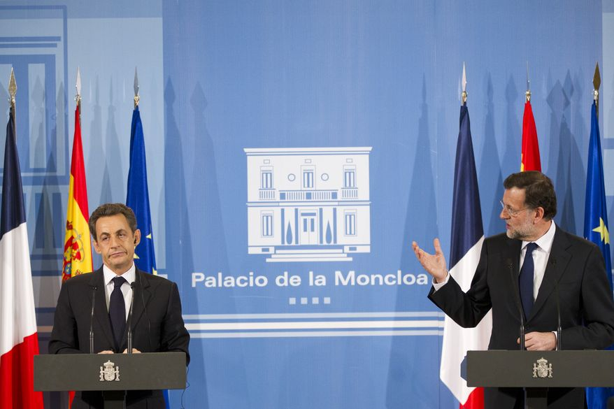 Spain's Prime Minister Mariano Rajoy (right) and French President Nicolas Sarkozy attend a join press conference Jan. 16, 2012, after a meeting at the Moncloa Palace in Madrid. (Associated Press)