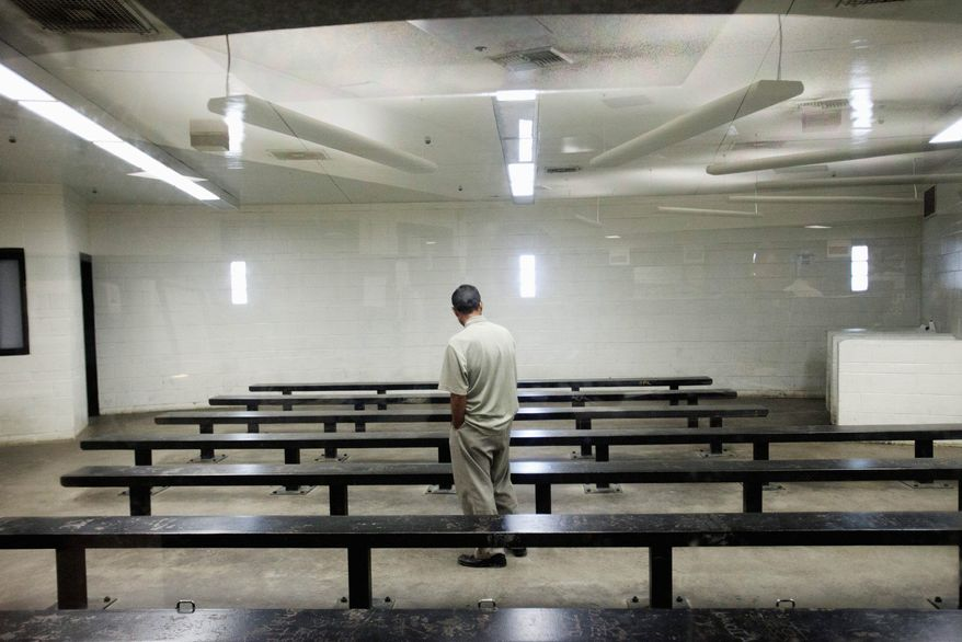 ** FILE ** A man waits to be processed at a Border Patrol detention center on Jan. 17, 2012, in Imperial Beach, Calif. (Associated Press)