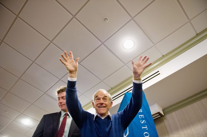Rep. Ron Paul of Texas waves to supporters after a campaign stop at a Holiday Inn in Rock Hill, S.C. Mr. Paul's non-interventionist stance has fueled his rise in the GOP presidential field. He finished in third place in Iowa and in second place in New Hampshire. (Andrew Harnik/The Washington Times)