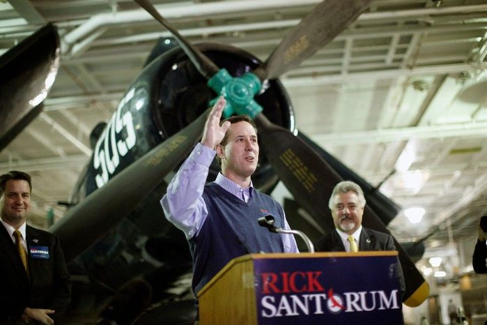 ** FILE ** Republican presidential hopeful Rick Santorum greets his audience at a gathering Tuesday on the USS Yorktown in Mount Pleasant, S.C. He is trying to convince voters in the run-up to the state's pr