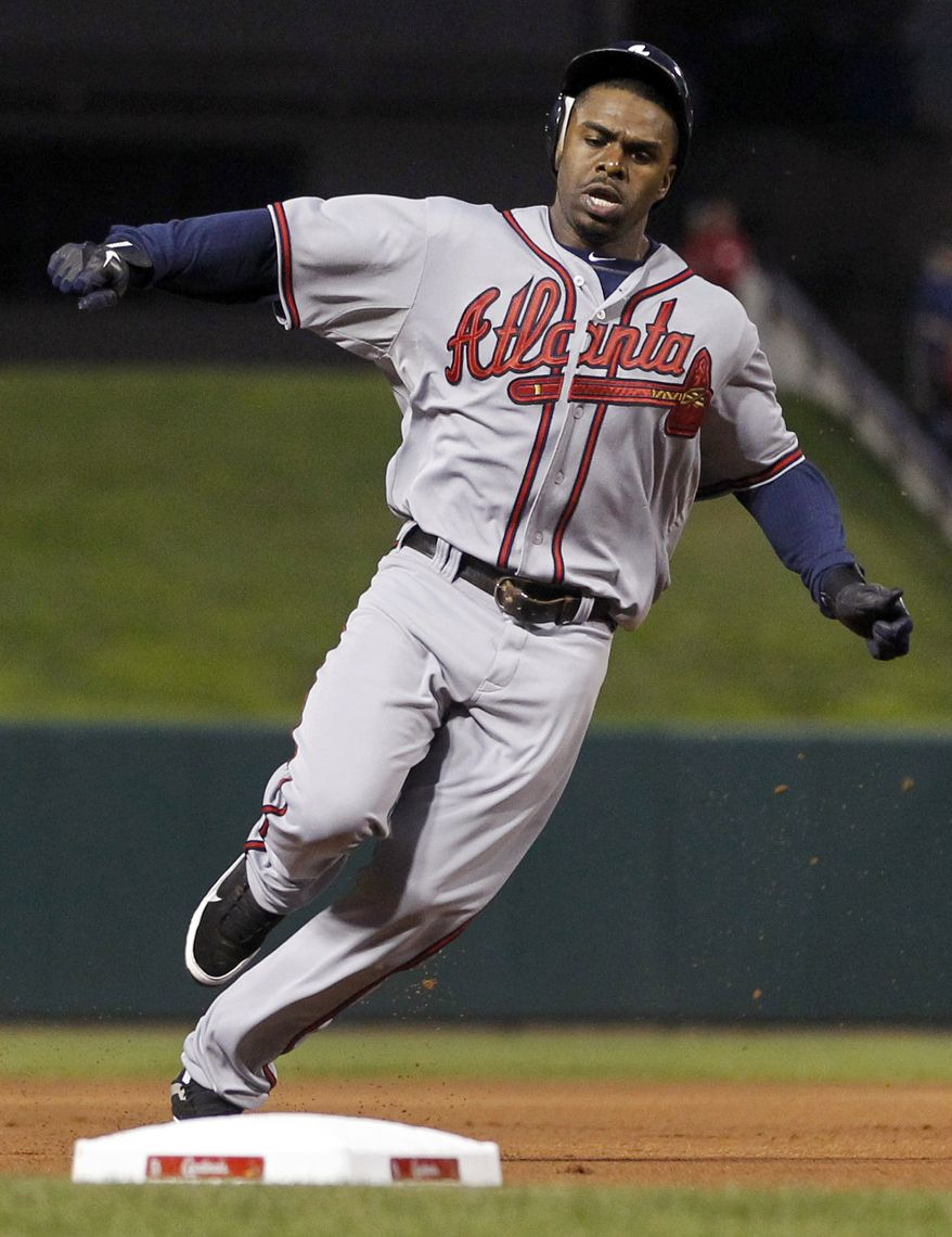 ** FILE ** In this Sept. 9, 2011, file photo, Atlanta Braves' Michael Bourn rounds third on a double by Brian McCann during the first inning of a baseball game against the St. Louis Cardinals in St. Louis. (AP Photo/Jeff Roberson, File)
