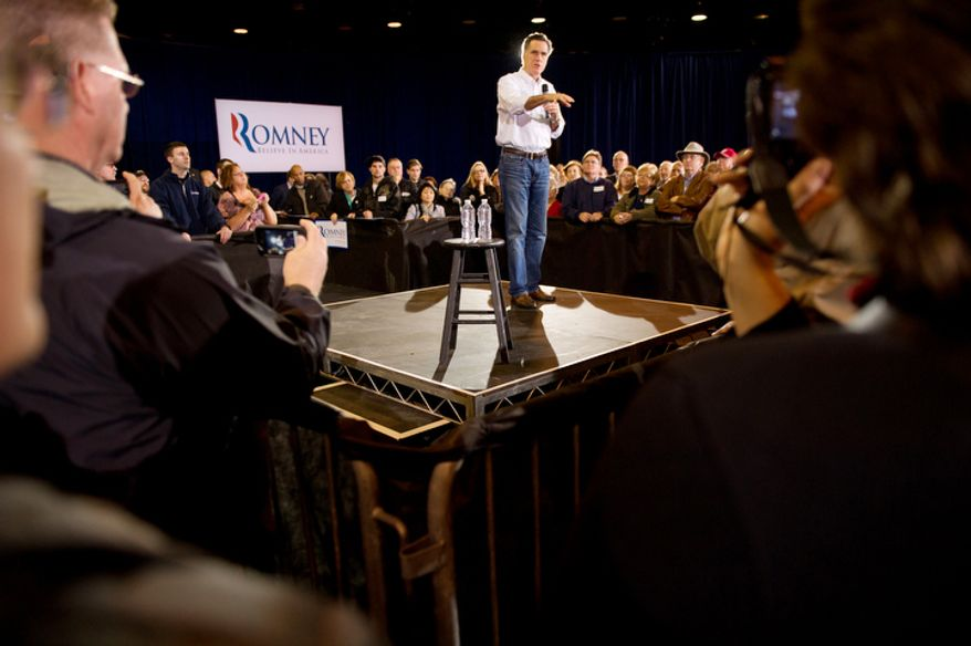 Republican Presidential candidate Mitt Romney speaks at an early morning campaign rally. (Andrew Harnik / The Washington Times)