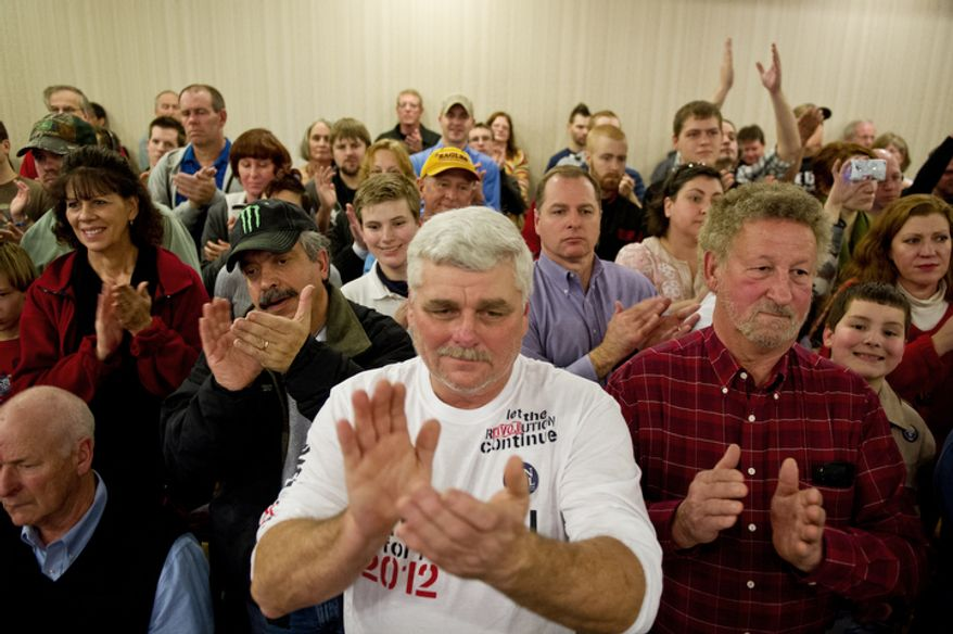 Ken Mercer of Bolivia, North Carolina, center, applauds with other members of the audience as Republican presidential candidate Ron Paul speaks during a campaign stop at a Holiday Inn, Rock Hill, SC.(Andrew Harnik / The Washington Times)