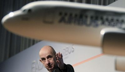 Louis Gallois, chief executive officer of EADS, which is Airbus' parent company, gestures during a news conference in Hamburg, Germany, on Tuesday, Jan. 17, 2012. (AP Photo/dapd, Philipp Guelland)