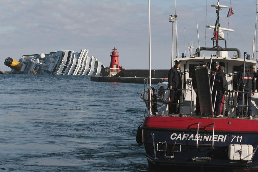 The cruise ship Costa Concordia lies on its side on Tuesday, Jan. 17, 2012, after running aground Friday night off the tiny Tuscan island of Giglio, Italy. (AP Photo/Gregorio Borgia)