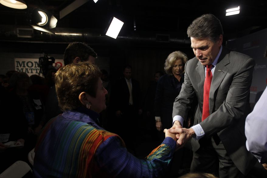 Texas Gov. Rick Perry meets with audience members after a CafeMom town hall in Myrtle Beach, S.C., on Monday, Jan. 16, 2012. (Associated Press)