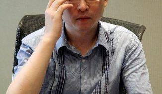Chinese writer Yu Jie (AP photo)
