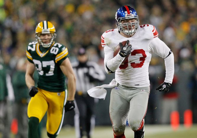 New York linebacker Chase Blackburn returns a fumble against Green Bay in their NFC playoff game last Sunday. He didn't play his first game this season until Dec. 4. (Associted Press)