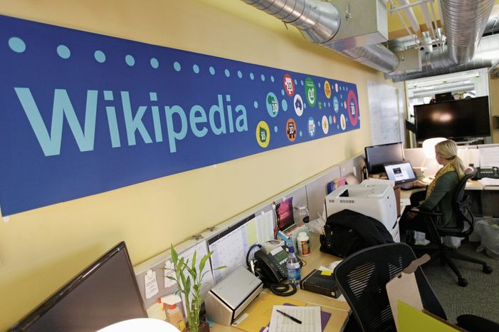 Mallory Whitt works at her desk at the offices of the Wikipedia Foundation in San Francisco on Wednesday. Wikipedia started a 24-hour blackout of its English-language articles, joining other