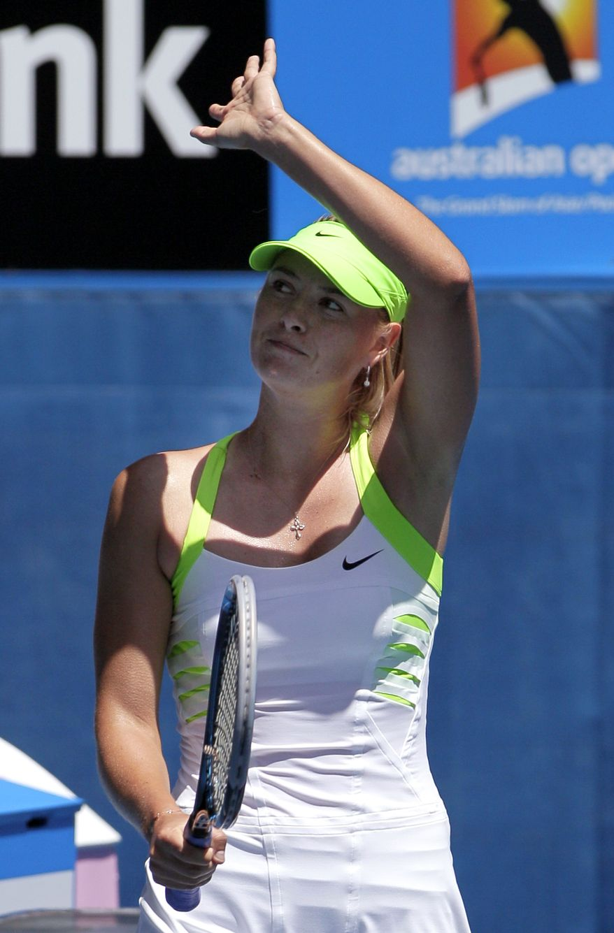 Maria Sharapova waves to the crowd after beating Jamie Hampton during their second-round match at the Australian Open in Melbourne, Australia, Thursday, Jan. 19, 2012. (AP Photo/John Donegan)