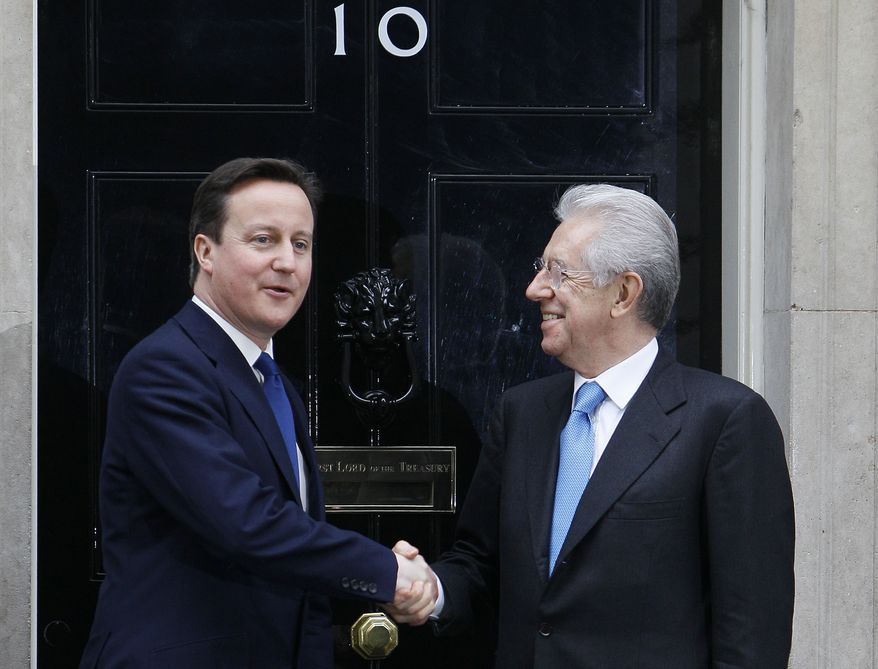 British Prime Minister David Cameron (left) greets Mario Monti, his Italian counterpart, outside 10 Downing Street in London on Wednesday, Jan. 18, 2012. (AP Photo/Alastair Grant)