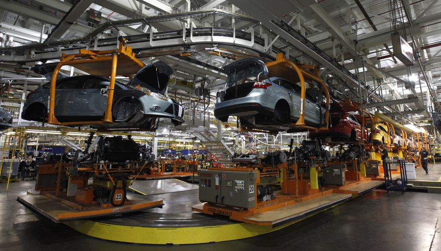 Ford Focus automobiles move on the assembly line at a Ford Motor Co. plant in Wayne, Mich., on Wednesday, Dec. 14, 2011. (AP Photo/Paul Sancya)