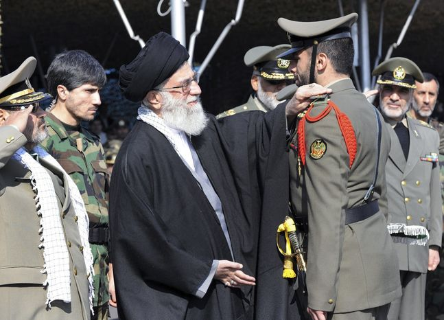 ** FILE ** In this Thursday, Nov. 10, 2011, file photo released by the official website of the Iranian supreme leader's office, Iranian supreme leader Ayatollah Ali Khamenei, center, confers a rank to an unidentified member of Iran's army during a ceremony, in Tehran, Iran. During a graduation at Iran's main army academy, the country's leader sketched out the Islamic Republic's tougher military posture. (AP Photo/Office of the Supreme Leader, File)