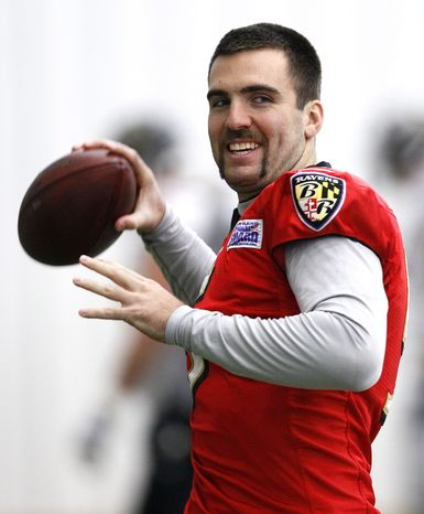 Baltimore Ravens quarterback Joe Flacco warms up at the team's practice facility in Owings Mills, Md., Wednesday, Jan. 18, 2012. The Ravens face the New England Patriots in the AFC Championship game Sunday. (AP Photo/Patrick Semansky)