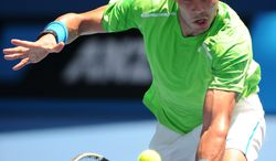 Spain's Rafael Nadal makes a backhand return to Germany's Tommy Haas during their second round match at the Australian Open tennis championship, in Melbourne, Australia, Wednesday, Jan. 18, 2012. (AP Photo/Andrew Brownbill)