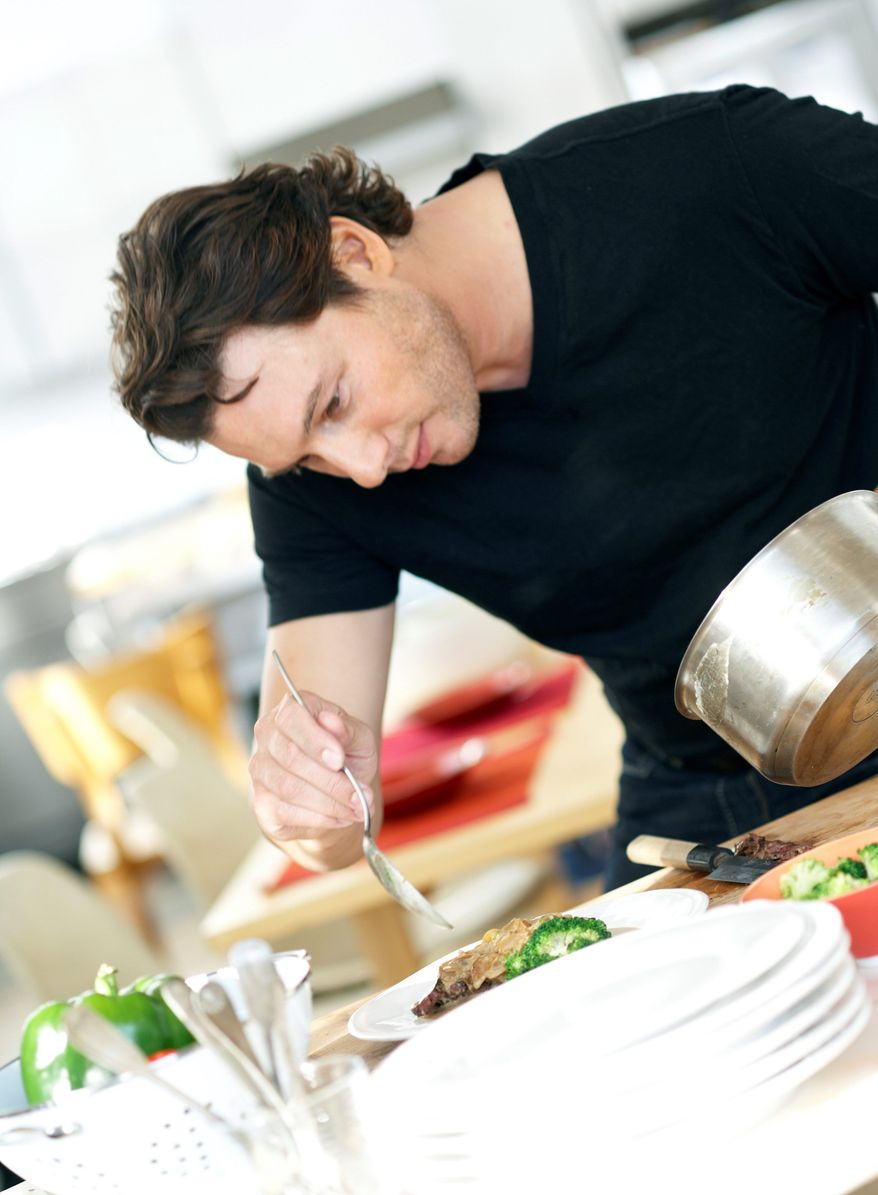 Cookbook author Rocco DiSpirito serves up his braised chicken with mushrooms and mustard, perfect for a hearty winter meal. It can be made in a slow cooker or in the oven. (Associated Press)