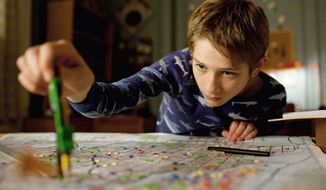 "Thomas Horn as Oskar Schell hopes to find something to help him connect with the father he lost in the Sept. 11 attacks in ""Extremely Loud & Incredibly Close."" (Warner Bros. Pictures via Associated Press)"