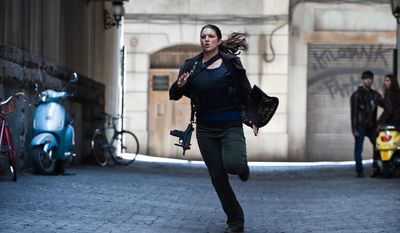 "Gina Carano plays mercenary intelligence operative Mallory Kane in ""Haywire,"" the new action thriller from director Steven Soderbergh and writer Lem Dobbs. (Relativity Media via Associated Press)"