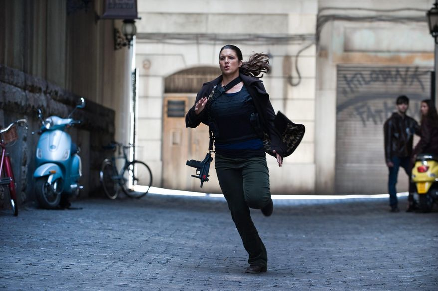 """Gina Carano plays mercenary intelligence operative Mallory Kane in """"Haywire,"""" the new action thriller from director Steven Soderbergh and writer Lem Dobbs. (Relativity Media via Associated Press)"""