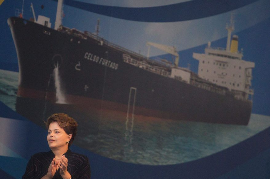 Brazil's state-controlled oil company expects to pump 4.9 million barrels of oil a day by 2020, and much of it will go to China. President Dilma Rousseff in November celebrated the delivery of one of four Brazilian-built oil-transport ships. (Associated Press)