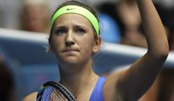 Victoria Azarenka celebrates after defeating Mona Barthel during their third-round match at the Australian Open, in Melbourne, Australia, Friday, Jan. 20, 2012. (AP Photo/Rick Rycroft)