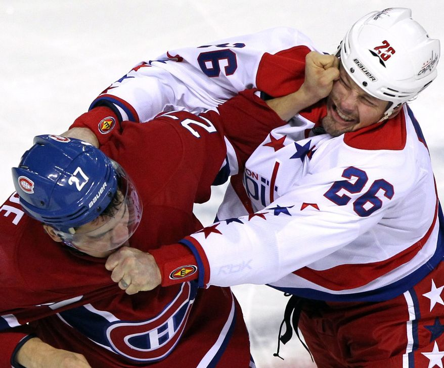 Montreal Canadiens left wing Rene Bourque trades punches with Washington Capitals left wing Matt Hendricks during a first-period fight Wednesday, Jan.18, 2012, in Montreal. (AP Photo/The Canadian Press, Tom Boland)