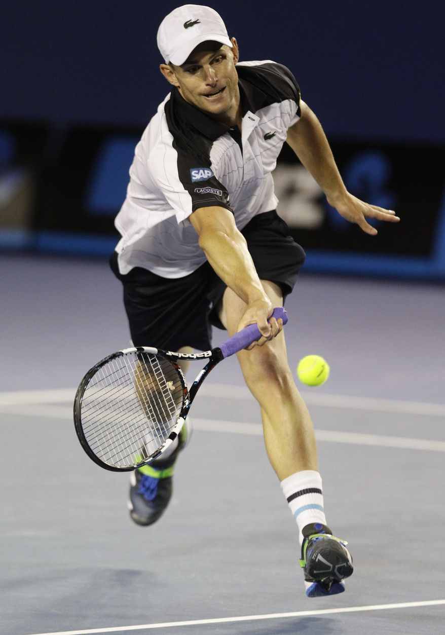 Andy Roddick of the U.S. reaches for a forehand return to Australia's Lleyton Hewitt during their second round match at the Australian Open tennis championship, in Melbourne, Australia, Thursday, Jan. 19, 2012. (AP Photo/John Donegan)