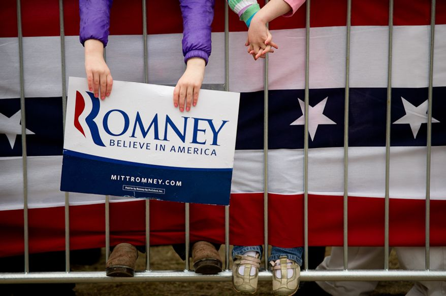 Children stand Jan. 20, 2012, on a fence as Republican presidential candidate and former Massachusetts Gov. Mitt Romney speaks at a campaign rally at the Harmon Tree Farm in Gilbert, S.C. (Andrew Harnik/The Washington Times)