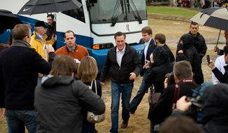 Republican presidential candidate and former Massachusetts Gov. Mitt Romney arrives Jan. 20, 2012, at a campaign rally at the Harmon Tree Farm in Gilbert, S.C. (Andrew Harnik/The Washington Times)