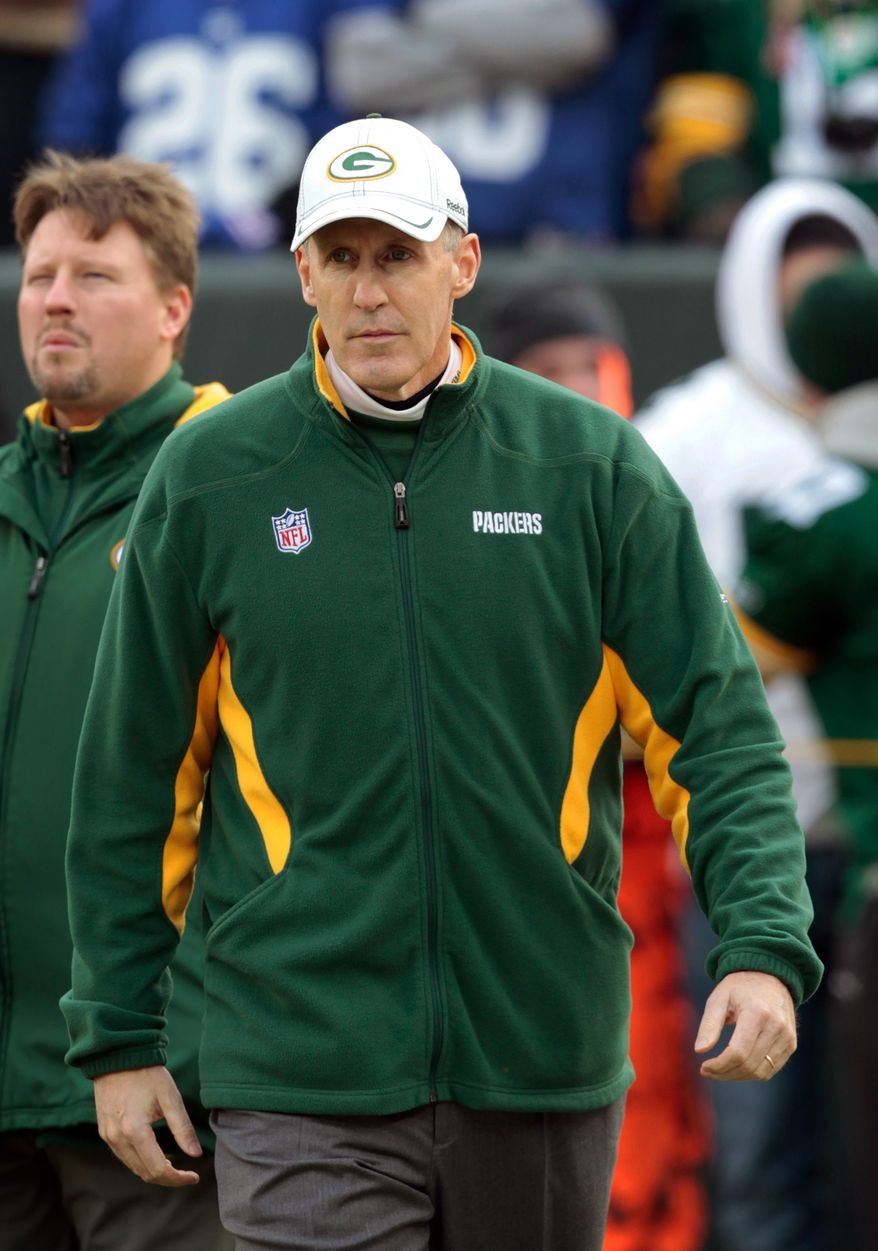FILE - In this Jan. 15, 2012 file photo, Green Bay Packers offensive coordinator Joe Philbin walks on the field before an NFL divisional playoff football game against the New York Giants, in Green Bay, Wis. Philbin on Friday was named the Miami Dolphins head coach. (AP Photo/Mike Roemer, File)