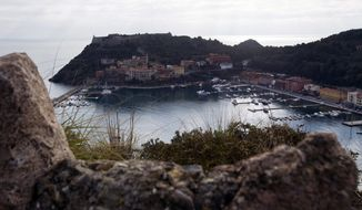 Porto Ercole, along the Argentario coast of Italy, is seen here on Jan. 18, 2012. A half-million gallons (2,400 tons) of fuel inside the capsized Costa Concordia cruiser liner risk polluting some of the Mediterranean's most pristine sea. (Associated Press)