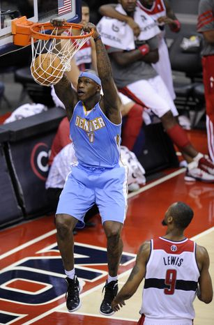 Denver Nuggets forward Al Harrington dunks against Washington Wizards forward Rashard Lewis during the second half, Friday, Jan. 20, 2012, in Washington. The Nuggets won 108-104. (AP Photo/Nick Wass)