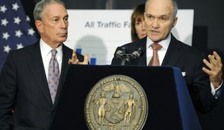 **FILE** New York City Police Commissioner Ray Kelly (right) speaks Dec. 29, 2011, at a news conference in Brooklyn, N.Y., as Mayor Michael Bloomberg listens. (Associated Press)