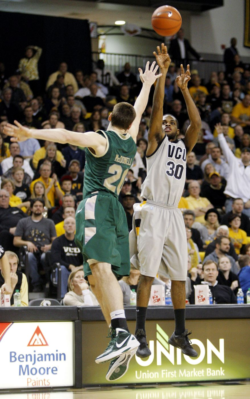 Virginia Commonwealth's Troy Daniels shoots over William & Mary's Quinn McDowell during the second half, Thursday, Jan. 19, 2012, in Richmond, Va. Daniels had seven points as Virginia Commonwealth won 69-68 in overtime. (AP Photo/Richmond Times-Dispatch, Eva Russo)